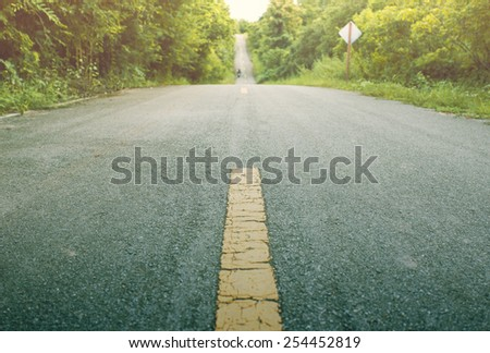 Focus on the Street. forest country road, vintage style. - stock photo
