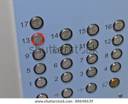 Focus on the thirteenth floor button elevator control panel - stock photo