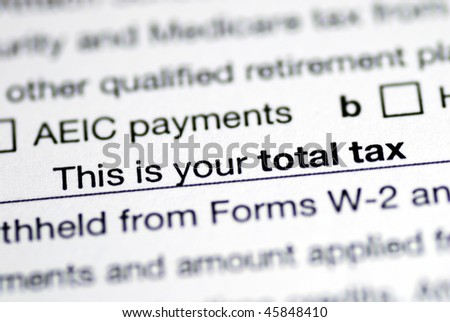 Focus on the total tax in the income tax return - stock photo
