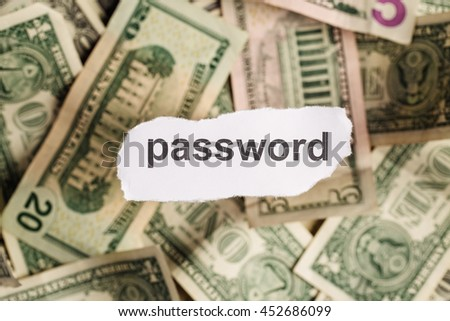 Focus on the word PASSWORD on piece of torn white paper with USD