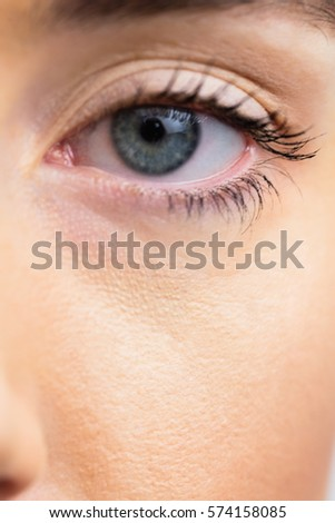 Focus on womans eyes in a studio