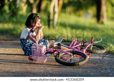 Focus selectively girl hurt crashing a bicycle accident.