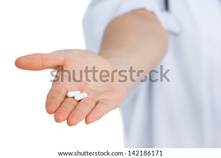 Focus shot on drugs placed in hand