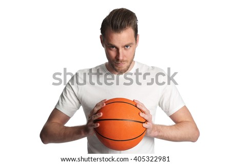 Focused basketball player wearing a white tshirt and holding a basketball. Standing against a white background staring at camera. - stock photo