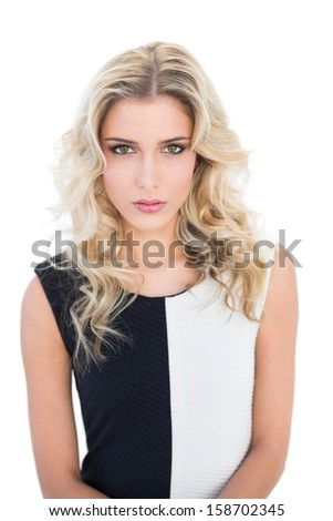 Focused blonde model looking at camera on white background - stock photo