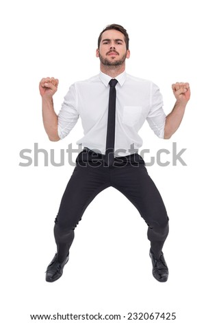 Focused businessman lifting up something heavy on white background
