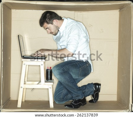 focused businessman working on a laptop - stock photo