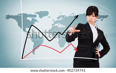 Focused businesswoman pointing against blue world map on white background - stock photo