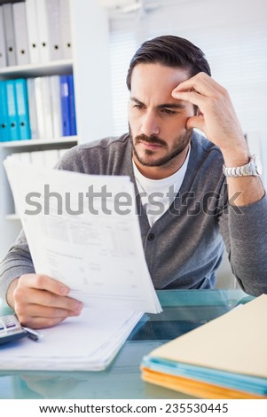 Focused casual businessman working at his desk in the office