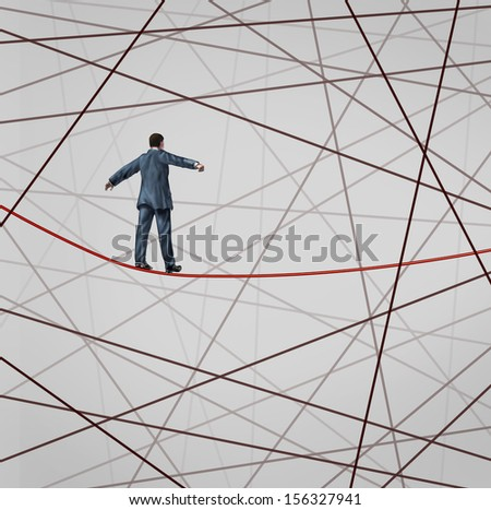 Focused On Strategy with a businessman as a high wire tight rope walker confronting adversity as a web of confused tangled group of wires distracting from the planned business goal for success. - stock photo