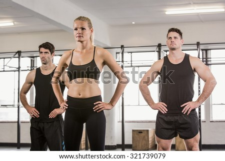 Focused people with hands on hip at the gym - stock photo