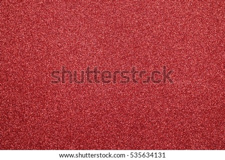 Focused red abstract texture glitter background