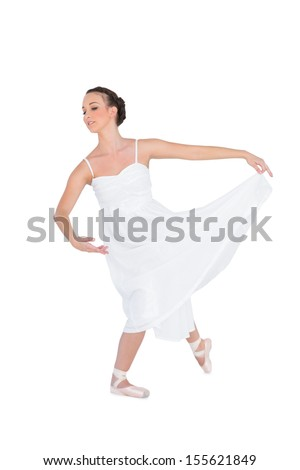 Focused young ballet dancer posing on white background with her leg back - stock photo
