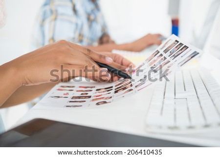Focused young editorial team working at desk in their office - stock photo