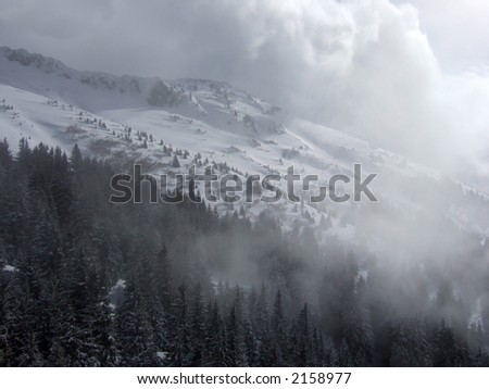 fog and clouds in big ski valley - stock photo