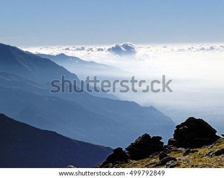 Fog and clouds in the morning over the valley called valle di Susa, western alps, piedmont, Italy