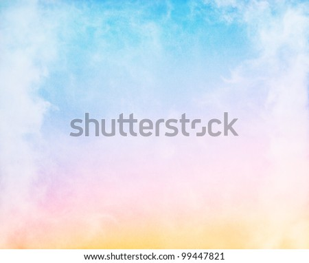 Fog and clouds on a colorful rainbow blue to orange gradient.  Image displays a pleasing paper grain and texture at 100%. - stock photo