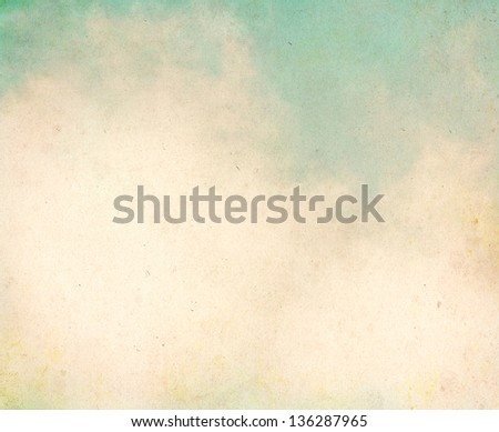 Fog and clouds on a textured, vintage paper background with grunge stains.  Image displays a pleasing grain texture at 100%. - stock photo