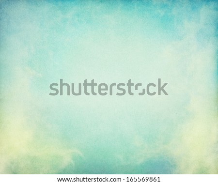Fog and clouds on a vintage paper background.  Image displays a pleasing paper grain and texture at 100 percent.  - stock photo