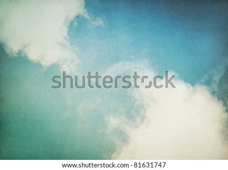 Fog and clouds on a vintage, textured paper background with a color gradient.  Image has a distinct and pleasing paper grain at 100%. - stock photo