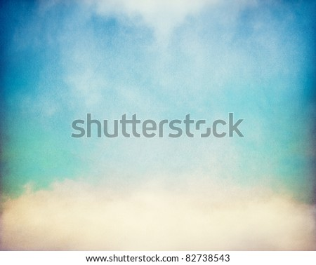 Fog and clouds on a vintage, textured paper background with a color gradient.  Image has a distinct paper grain at 100%. - stock photo