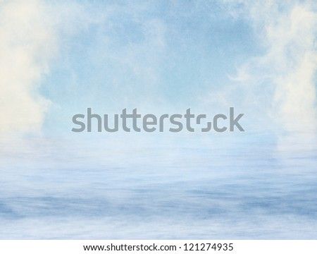 Fog and clouds over water overlaid with a textured paper background.  Image displays a pleasing grain at 100%. - stock photo