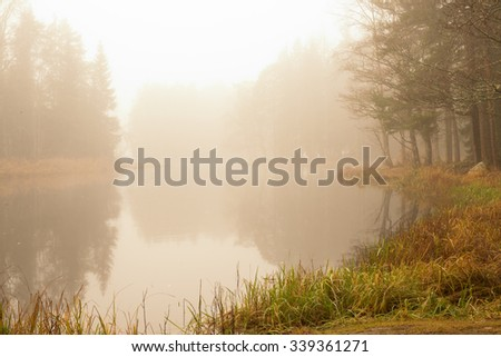 Fog and mist on a river in autumn - stock photo