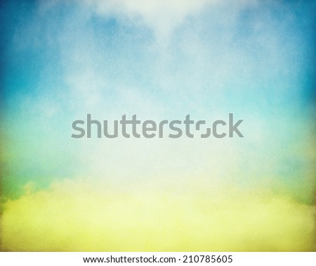 Fog and mist rising from a glowing pool of yellow and green light.  Image has a distinct paper texture and grain pattern visible at 100 percent. - stock photo