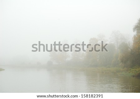 fog and river - stock photo