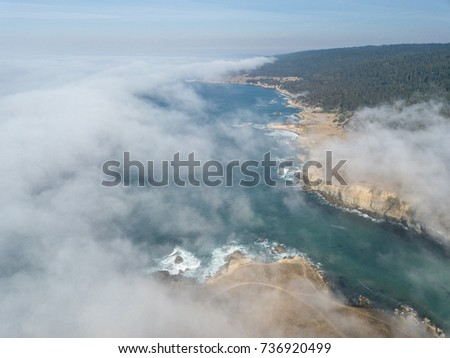 Fog begins to drift across the northern California coastline in Sonoma. Thick fog, generated by a layer of cool, coastal air trapped beneath a layer or warm, dry air, is common in this scenic region.