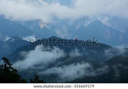 Fog covering the mountain forests in Sabah Borneo, Malaysia. Kinabalu Reserve Forest
