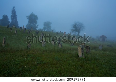 Fog in a jewish cemetery - stock photo