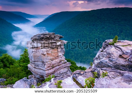 Fog in the Blackwater Canyon at sunset, seen from Lindy Point, Blackwater Falls State Park, West Virginia. - stock photo