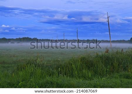 Fog in the morning light - stock photo