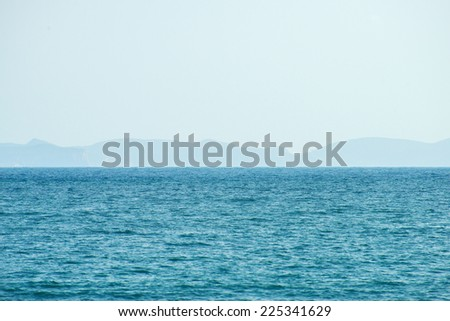 Fog in the ocean. Islands in the distance. - stock photo