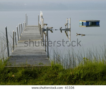 Fog is lifting over Round Lake - stock photo