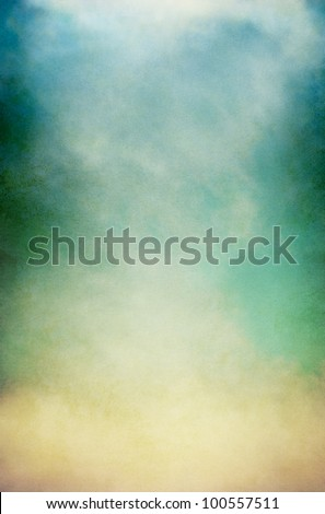 Fog, mist, and clouds on a vintage, textured paper background with a color gradient.  Image has a pleasing paper grain pattern at 100%. - stock photo