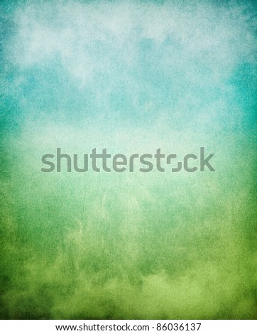 Fog, mist, and clouds with a green to blue gradient.  Image has a pleasing paper texture and grain pattern visible at 100%. - stock photo