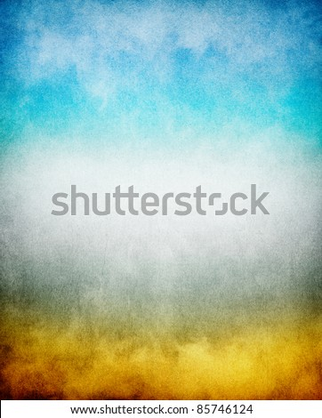Fog, mist, and clouds with a yellow to blue gradient.  Image has a pleasing paper texture and grain pattern visible at 100%. - stock photo