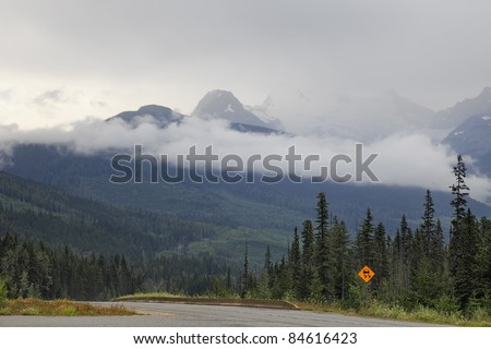 Fog on road through mountain pass (British Columbia. Canada)