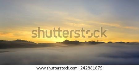 Fog on the mountain at sunset, panorama - stock photo