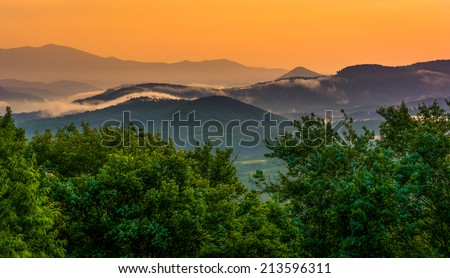 Fog over the Appalachian Mountains at sunset, seen from the Blue Ridge Parkway in North Carolina. - stock photo