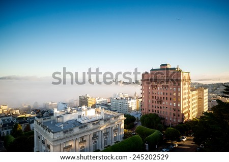 Fog Rolls in over San Francisco Bay beyond Luxury Apartments and Condominiums in Pacific Heights - stock photo
