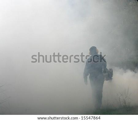 Fogging to prevent spread of dengue fever. - stock photo