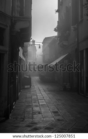 Foggy alley in Venice - stock photo