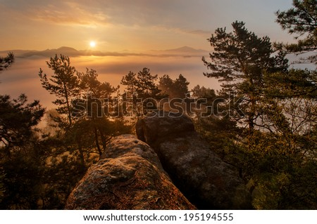 Foggy and misty morning on the sandstone view point in national park Bohemian Switzerland - stock photo