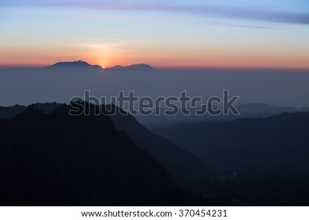 Foggy and volcano mountain during sunrise taken from Pinajagun II view point ,Indonesia