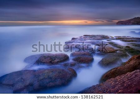 Foggy Australian Bay Beach Area - stock photo