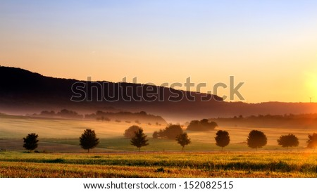 Foggy Bavarian Sunrise - stock photo