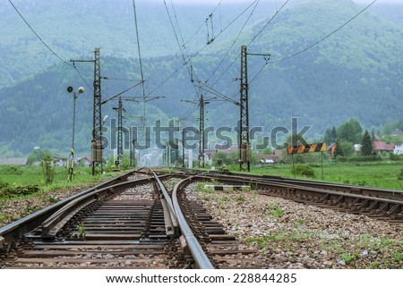 Foggy day on the high mountain railway station - stock photo